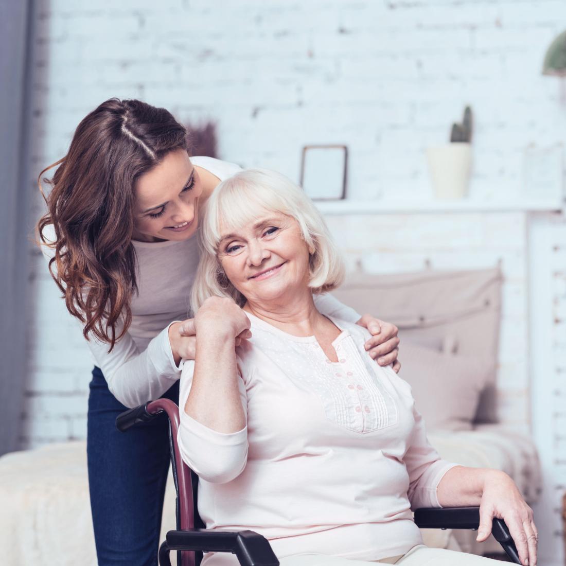 Elderly lady hugged by daughter