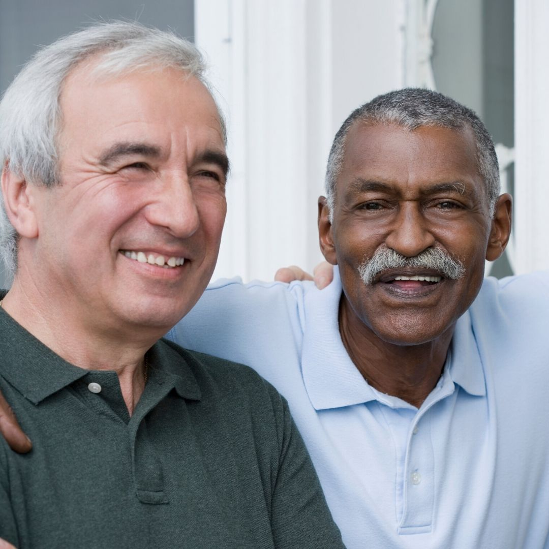 Senior Caucasian male and African American male smiling
