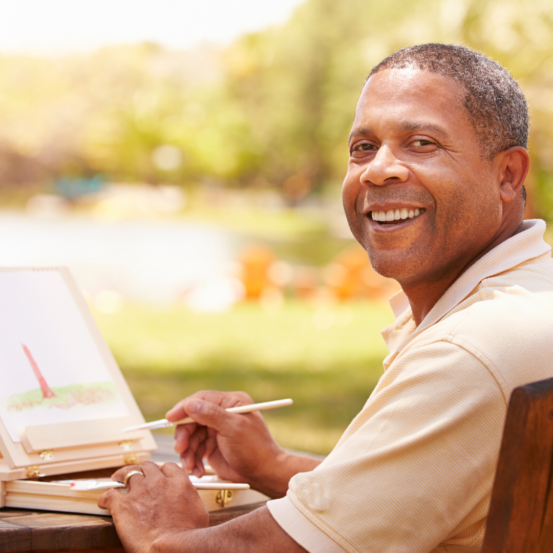 African American man painting outdoors